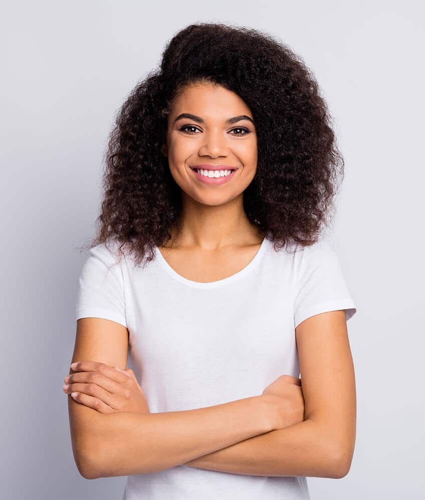 young african american woman smiling with arms crossed